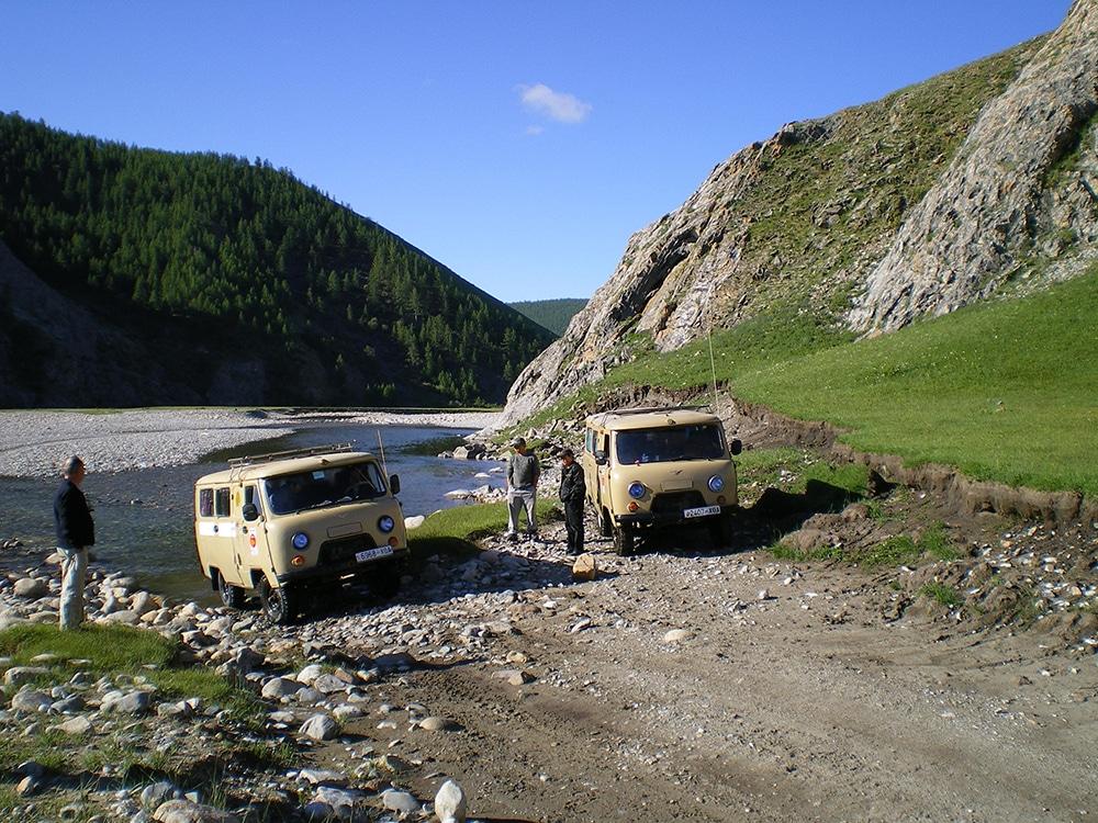 Safari busses crossing a river