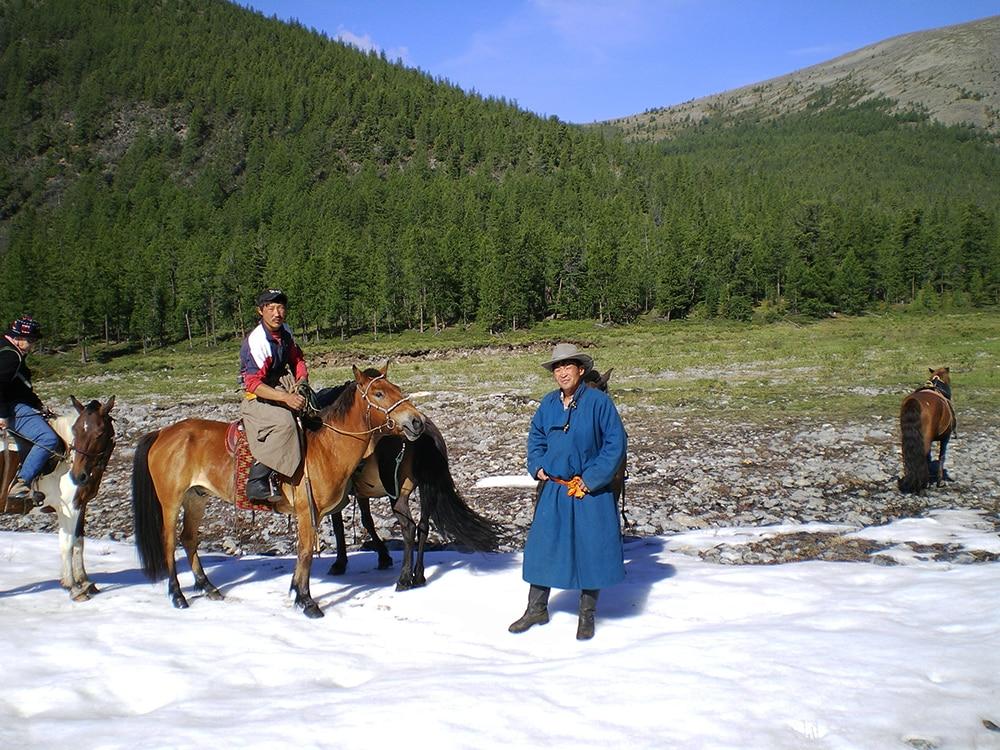 Tsaatan reindeer breeders standing in snow