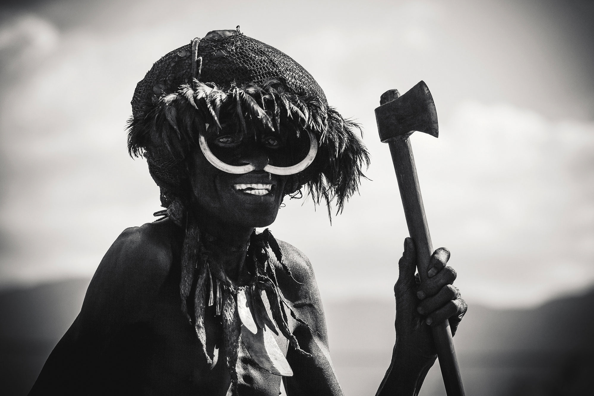 Portrait tribal Papuan with nose piercing axe