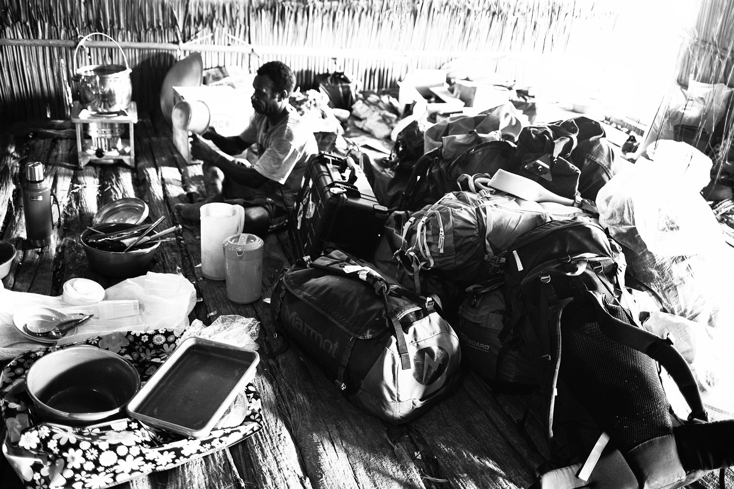 asmat camp with travel luggage