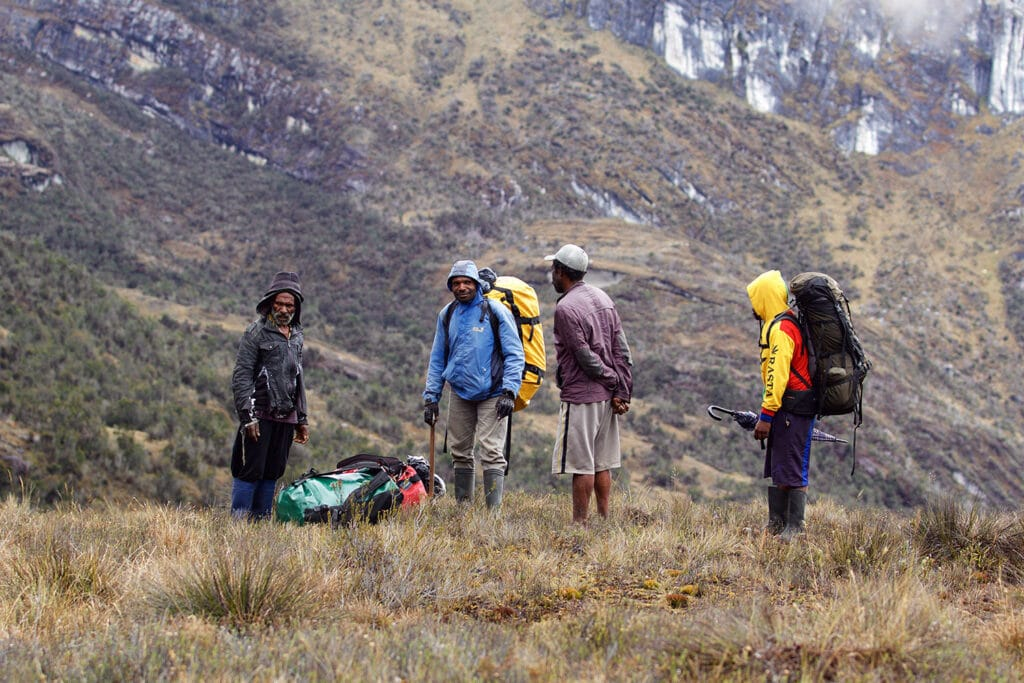 trikora porters trekking mountain view