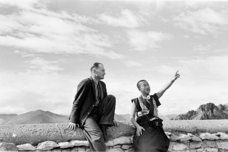 Heinrich Harrer and the young Dalai Lama sitting