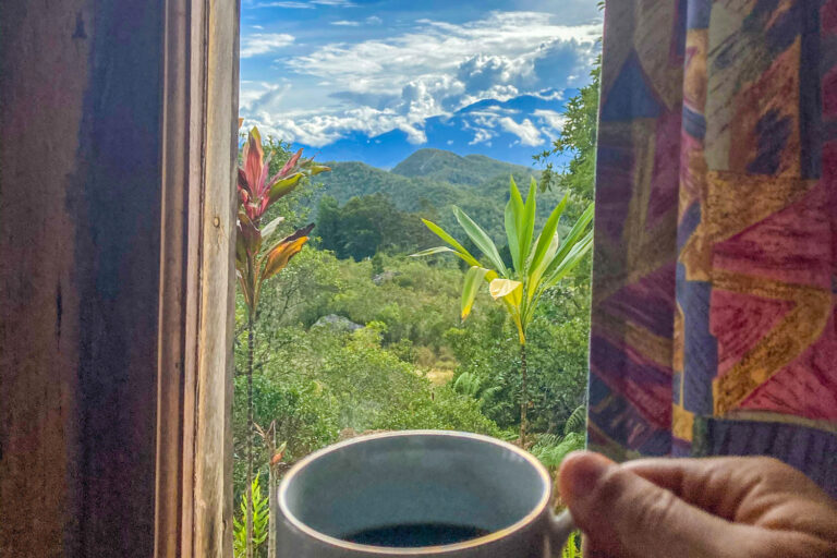 Having a cup of coffee in The Baliem Valley Resort bungalow